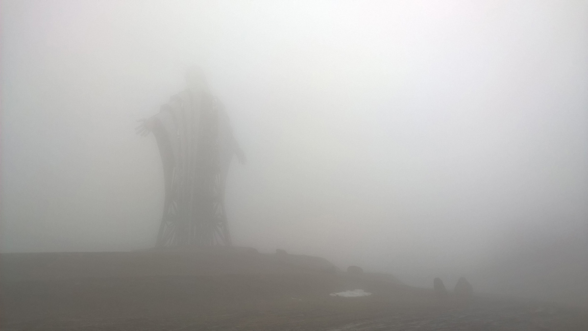 The statue of Jesus appearing in the fog
